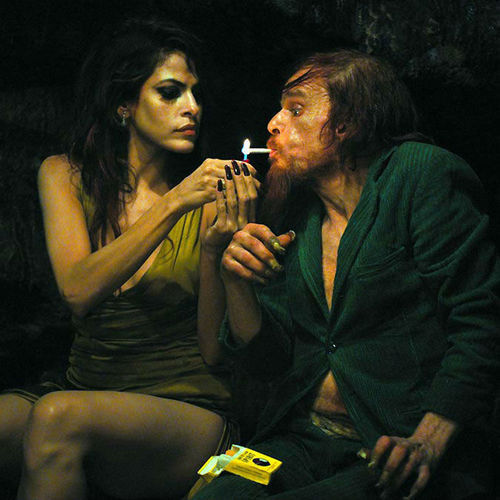 Eva Mendes and Denis Lavant in Holy Motors.