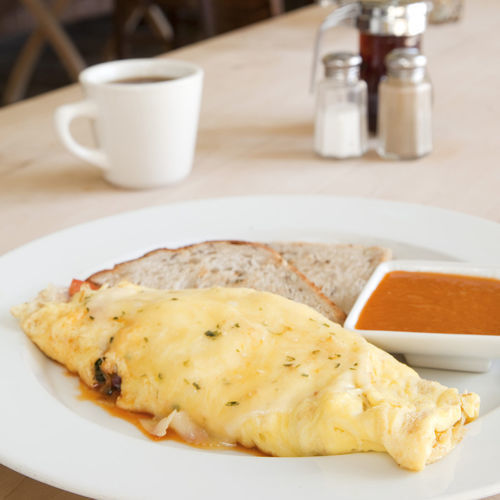 "The ""honey badger omelet"" is stuffed with chorizo and red onions."