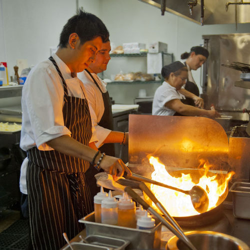 Guerrero works the woks at Alma to create chifa-style dishes that fuse Chinese and Peruvian food in one of the country's signature hybrid cuisines.