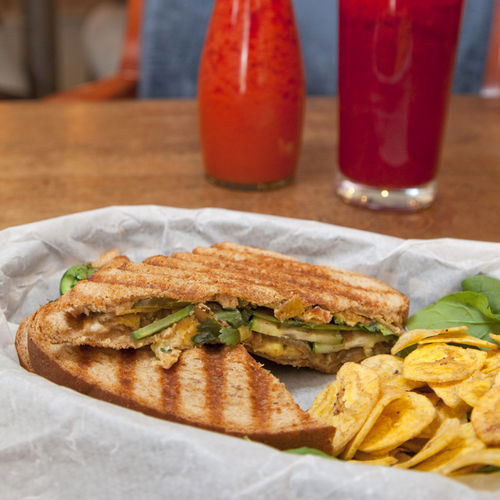 The Mumbai Streets panini features potato samosa stuffing, cucumber, tamarind chutney and  jalapeños.