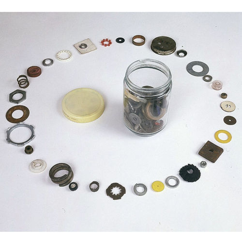 Washers, caps and plastic gaskets make up Round Things with a Hole in the Middle Most of the Time.