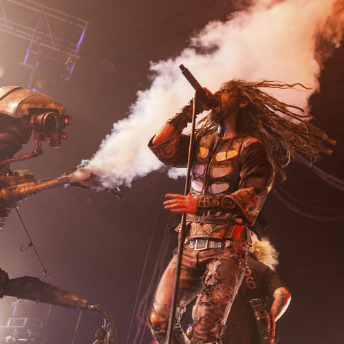 Rob Zombie, evil motherfucker, gets sprayed for West Nile during his pre-Halloween concert.