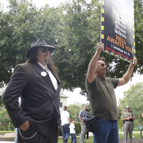 Aron Ra poses for photos with Houston street preacher David Stokes.