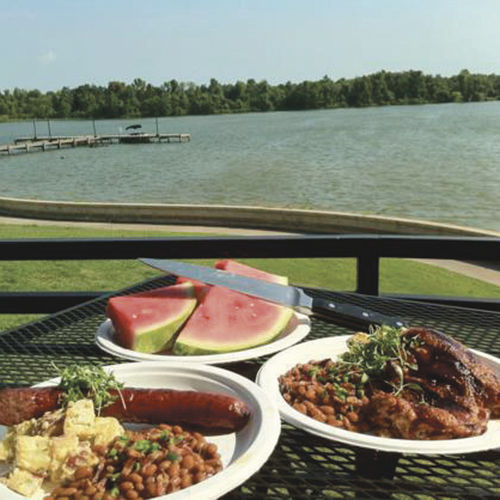 The Tasting Room's patio in Kingwood overlooks a serene Lake Houston.