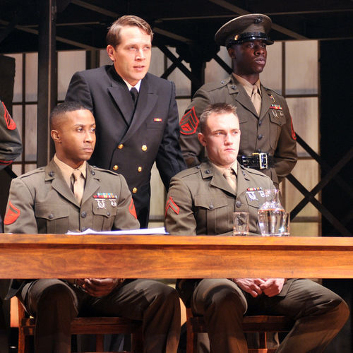 Actor Jeremy Webb (standing) portrays the defense attorney for two marines charged with murder, played by David Pegram and Max Carpenter (seated).  Also standing is actor Tristien Marcellous Winfree, who portrays a military policeman.
