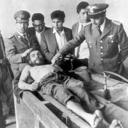 Members of the Bolivian military display the body of Che Guevara — proof that he was dead.