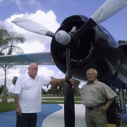 Gustavo Villoldo (left) stands by a B-26 with Salvador Miralles, another Bay of Pigs veteran. Gustavo had the co-pilot's seat in 1961 when the plane's napalm-filled torpedo failed to drop.