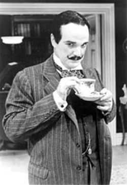 James Black as Hercule Poirot