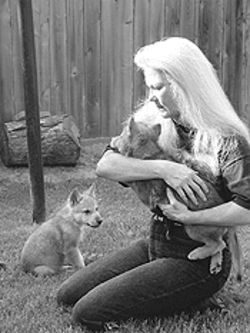 Ott, with two of the abused wolf pups rescued from New Mexico.