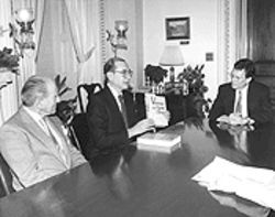 Schecter, accompanied by retired admiral Zumwalt, discusses his research with Senator Daschle.