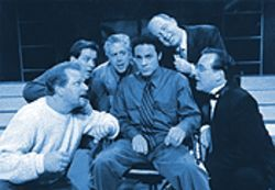 Misery loves company: The husbands work their propaganda on Robert (Ilich Guardiola) in Stages' production of Company.