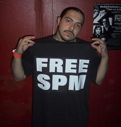 "Producer Pete ""Dirty Werk"" Camarillo shows off his Free SPM shirt at the recent Texas Latin Rap Awards."