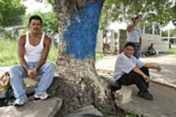 Honduran immigrants Jose (left) and Carlos wait for 