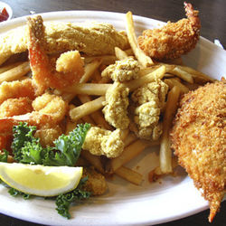 Indulge in the fried seafood with the &amp;shy;fisherman&#039;s platter.
