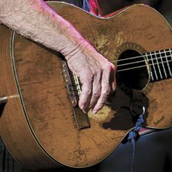 This guitar is to a regular guitar what Keith Richards is to a regular human being — lots more miles and stories, and all of them displayed proudly. The hand, though, just looks like Keith Richards's face. Willie Nelson, at the recent Family Picnic here in Houston. To view image larger, click here.