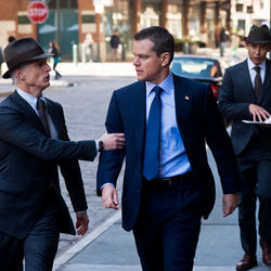 Matt Damon (center) is pursued by the Adjustment Bureau.
