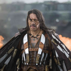 Machete (Danny Trejo) kills bad guys on all sides.