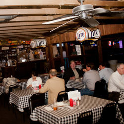 Blanco&#039;s checkered tablecloths are among its many honky-tonk details.