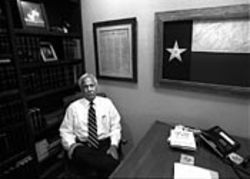 Texas memorabilia, Cigar Aficionado magazine  and Sun Tzu: Rosenthal in his lair.