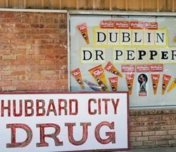The Hubbard City Drug Store advertises Dublin Dr Pepper in the front window.
