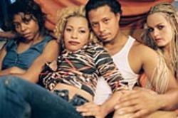 A pimp and his hoes, played by Terrence Howard,  Paula Jai Parker and Taryn Manning.