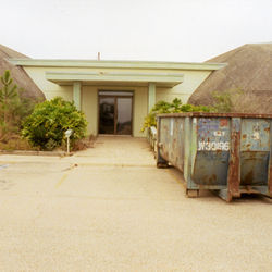The visitors center at the South Texas Nuclear Plant is abandoned and choked with weeds.