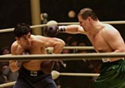 Inspirational but not hokey: Russell Crowe (with Art  Binkowski, right) as Cinderella Man.