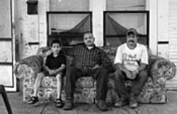 Ignacio Aguilera Jr. (center, with his nephew and father) had to stop his mother from killing herself.