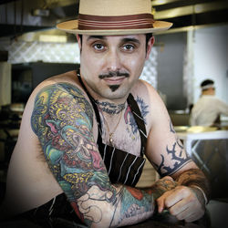 Michael Dei Maggi, executive chef and proprietor of The Rockwood Room, displays his colorful sleeves and fighting chicken tattoos with the kind of cheeky and playful attitude that comes across in his cooking. Click here to view the entire photo feature.