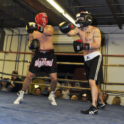 "Boudwin (right) spars with Eric ""Grizz"" McMahon as part of a charity boxing match in March."