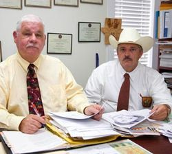 Investigators Coffman (l) and Rosser have not had any promising leads.