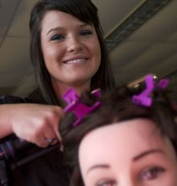 Kim Howard spends two hours styling hair every afternoon at Miller Career & Technology Center in Katy ISD.