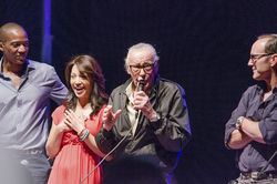 J. August Richards, Ming-Na Wen and Clark Gregg from the hit television Avengers spin-off Agents of S.H.I.E.L.D. watch as legendary Marvel comics creator Stan Lee takes the microphone at a panel discussion.