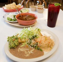 At Casa de Leon, some of the food is authentic (the birria, back), and some is less so (the chimichanga).