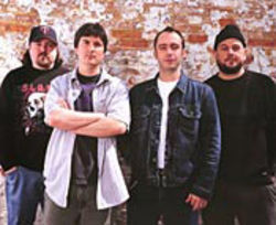 Minus guitarist Tim Sult (left), singer Neil Fallon (second from right) has to muster more of the pure rock fury.