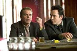 Vic (Billy Bob Thornton) and Charlie (John Cusack)  aren't so much partners; more like rivals joined at the  leather bag of cash stashed between them in the front  seat.