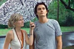 "She had him at ""Welcome aboard"": Claire (Kirsten  Dunst) will save Drew (Orlando Bloom) from himself."