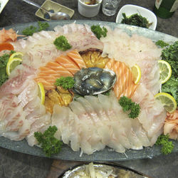 Behold an entire boat of Korean-style sashimi.