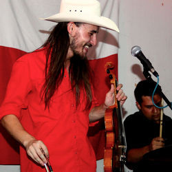Robert Ellis (left, with drummer Ryan Chavez) says he shares vintage honky-tonk YouTube clips with many of the people he met at his Mango's residency.