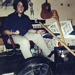 Joe Mathlete, then 17, cools off in his bedroom studio.