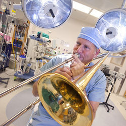 Billy Cohn takes an unscheduled trombone break in the St. Luke's operating theater.