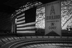 Banners hang over an empty Astrodome.