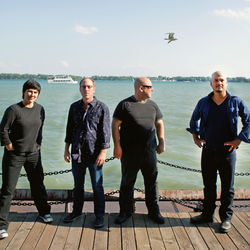 YouTube helped Pixies drummer David Lovering, second from left, remember his Doolittle parts.