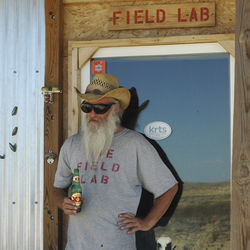 John Wells, a self-described moderate prepper, stands at the door of his shipping-container house outside of Terlingua, Texas. Wells keeps a blog about living off the grid, called The Field Lab, that he updates daily.