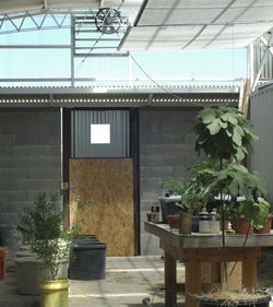 Wells is constructing a greenhouse out of shipping containers, which he also uses for rainwater collection. He eventually hopes to grow enough food to feed himself and to live off $10,000 a year.