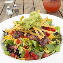 Have a steak and avocado salad and a Lunch Punch in the garden.