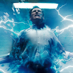 Dr. Manhattan (Billy Crudup) is a mutated atomic scientist who glows blue.