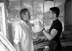 Tom Cruise and Steven Spielberg have a close encounter (oh, so ugh) on the set of Minority Report.