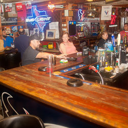 Note ashtrays on the bar: Smoking indoors is just one retro aspect of South Houston's Depot Saloon.