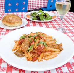 At Perbacco, the pasta with Italian sausage often comes with conversation.